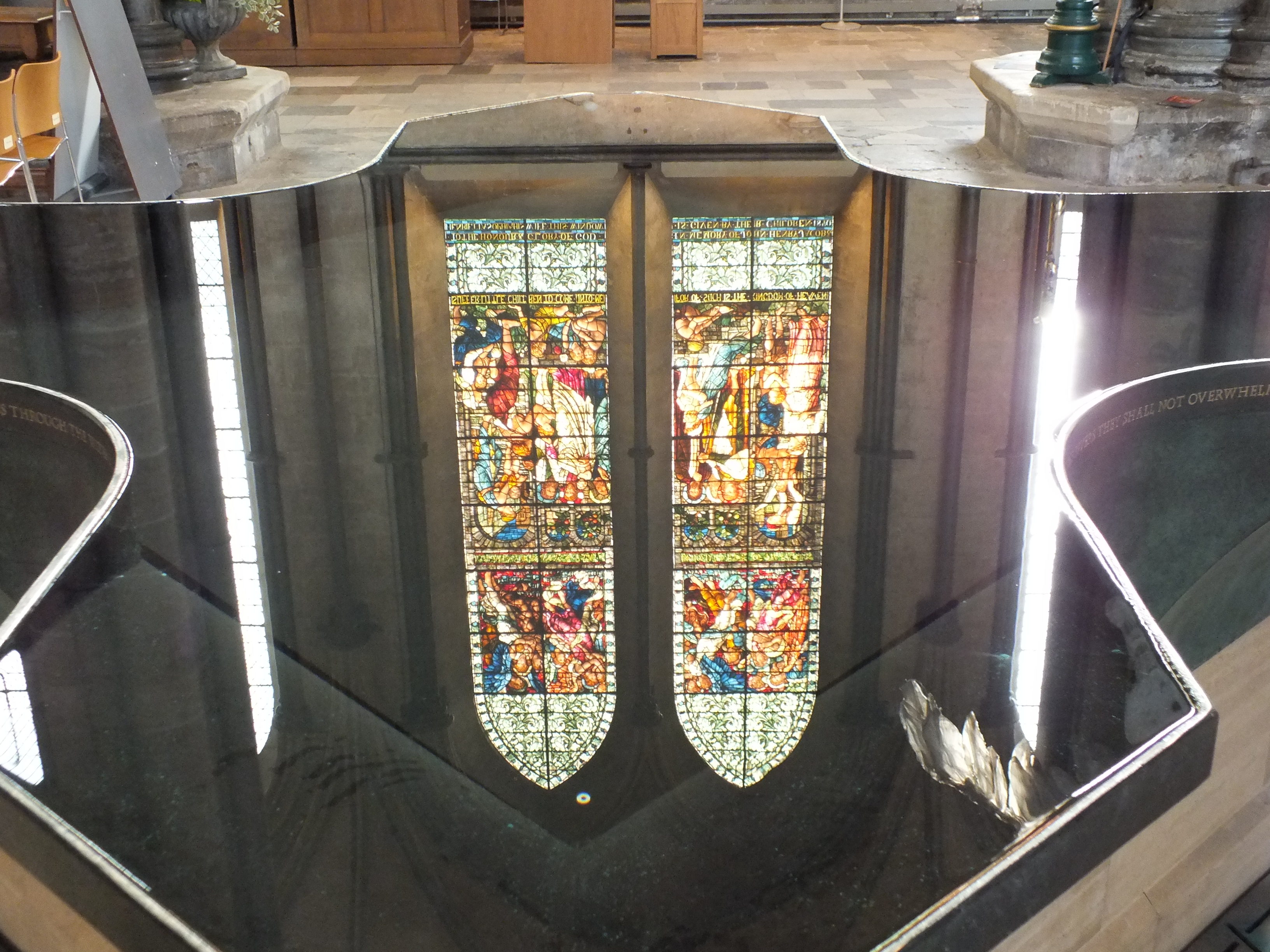 "William Pye's ""living water"" font reflecting stained glass"